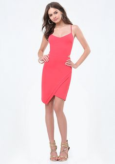 Perfect club dress in curve-hugging ponte and a faux asymmetric wrap design. Skin-baring cami bodice with side cutouts. Adjustable straps. Back hook-and-eye and exposed zip closure. Fully lined.