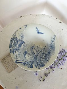 Here is a beautiful old French cake stand from the flea market in Nice.  It is one of my favorite cake stand with blue birds on the branch and butterfly on white background- the scenic is very soothing.  It is I great condition without any chips or cracks.  Stamped J V& Cie Bordeaux  Measures 8 3/4 diameter, 4 1/4 tall.