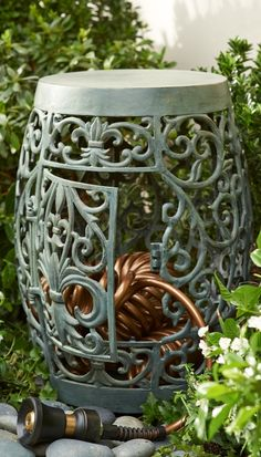 Featuring an attractive fleur-de-lis design, this decorative storage solution beckons you to pause and sit awhile in the garden—yet it also stores our quality-crafted 75 ft. coiled hose.
