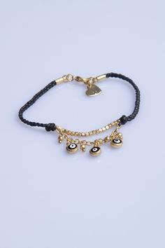 Black and Gold Eye Charms Bracelet     [$7.00]