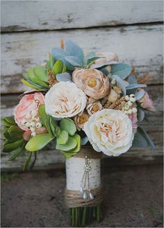 Use realistic-looking faux flowers to create an arrangement that will last forever.