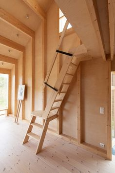 The cabin is complete with nooks around its edges for use as reading spaces, while a ladder provides access to a ceiling-height mezzanine level and hideout. Staircase Handrail, Wood Railing, Modern Staircase, Stairs, Wooden Hut, Wooden Cabins, Warehouse Living, Ski Jumping, Timber Cladding