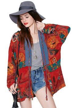 Seriously cool cardigan with abstract print, braided trim detail, accentuated collar, and fringe embellishment.
