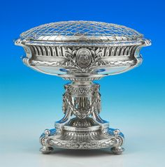 French silver jardiniere, c. 1860, applied with arms, supporters and motto LABORIS FORTUNA COMES below a coronet, fitted with a plated liner and flower cage.
