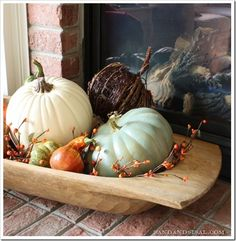 Love this use of a an antique dough bowl full of pumpkins for fall decorating.