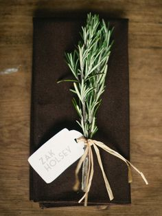 A sprig of rosemary at each place setting. Natural/simple detail that can be reused later (in any recipe)
