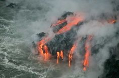 Fire meets water--volcano erupting lava into the ocean