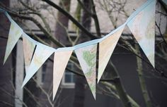 Map Bunting. Glue map triangle on the thick cardstock. Attach bias tape to both sides of the triangle, use a zig zag stitch to sew it up to from a loop for hanging the bunting. This serves as a perfect outdoor decor with the travelling map theme.