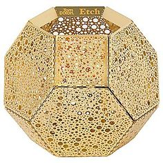 Geodesic flat pack candle holder by Tom Dixon.  Click the link to see it lit up!
