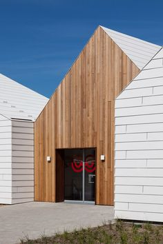 White EQUITONE facade panels meet wood. Livsrum Cancer Counselling Centre by EFFEKT. www.equitone.com