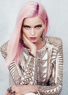 Pink hair, dramatic eye make up, bold lip and embroidered jacket. What's not to love?