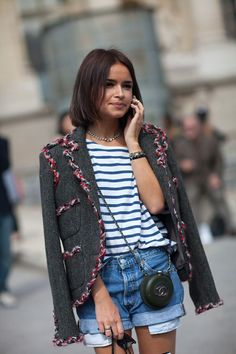 Miroslava Duma in a grey tweed jacket + striped tee + denim shorts