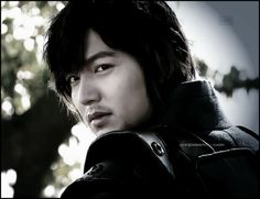 Lee Min Ho.  Never mind the hair...I spy STUBBLE lol