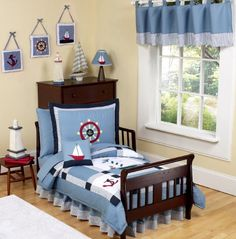 Come Sail Away 5 pc. Toddler Bedding Ensemble has all that your little sailor will need. This charming and classic set is decorated in a nautical theme with embroidered helm wheels, anchors, boats, and lighthouses set upon soft chambray fabric. A Chambray blue background with white, red, navy, yellow gingham, blue and white striped accents adorn this clever nautical themed set. This set is truly stunning. It is made of 100% cotton and every piece in inspected for the highest quality.