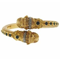 Zolotas Emerald Ruby Diamond Gold Chimera Bypass Bracelet | From a unique collection of vintage more bracelets at https://www.1stdibs.com/jewelry/bracelets/more-bracelets/