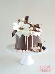 Chocolate and flowers drip cake