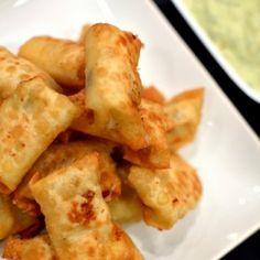 Monterey jack cheese, green chilis, and jalapenos are mixed and fried in a wonton wrapper. The avocado based dip is a perfect complement!
