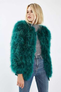 We love the luxe look of this marabou feather jacket In emerald green. In a stand-out style, it features hook and eye fastening. Throw over any casual or party piece for instant impact. #Topshop