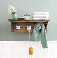 A towel rack made from vintage cross-handle faucet taps. Barn wood gives the piece a rustic look. Find the step-by-step to create your own at  This Old House , or let Salvage Style do the work for you.