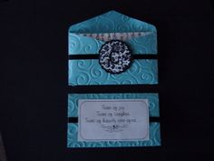 Invite is very similar to this - white damask embossed pocket. Will use color to accent.