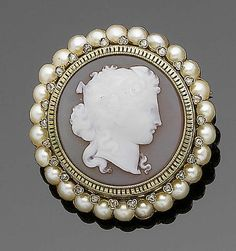 A hardstone cameo, pearl and diamond brooch The oval hardstone cameo depicting a classical maiden in profile, within a surround of rose-cut diamonds to a further row of half-pearls