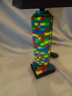 I can totally make this.  Lego Lamp  Multicolored Round Cylinder Lamp by LegoLamps on Etsy, $109.99