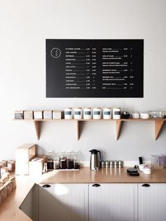 Simplistic cafe menu board and shelving. Cafe Interior Design, Cafe Design, Store Design, My Coffee Shop, Coffee Shop Design, Coffee Shops, Cafe Menu, Cafe Bar, Cafe Signage