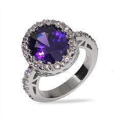 Embrace your romantic side with this sparkling purple oval cut sterling silver amethyst cz ring! This beautiful ring features an 8.5 mm purple amethyst cz oval stone outlined in 2 mm diamond cz stones that run down the sides of the band as well. The deep purple hue of the amethyst cz stone complements any outfit.