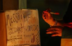 SYDNEY, AUSTRALIA - JUNE 13:  A woman writes a message during a candlelight vigil for the victims of the Pulse Nightclub shooting in Orlando, Florida, at Newtown Neighbourhood Centre on June 13, 2016 in Sydney, Australia. 50 people were killed and 53 injured after a gunman opened fire on people in a gay nightclub in Florida. It is the deadliest mass shooting in US history.  (Photo by Daniel Munoz/Getty Images)