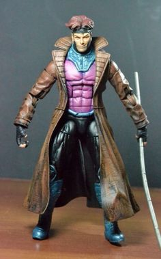 Gambit (Marvel Legends) Custom Action Figure by Eddiegrayce's Custom Recipe  Black panther body Head gambit Trench coat,arms,hands punisher Rest was sculpted
