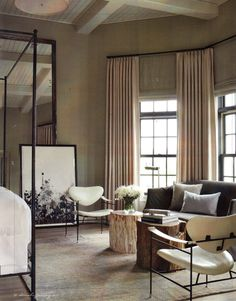 Curtains high, reclaimed stumps, modern and white.