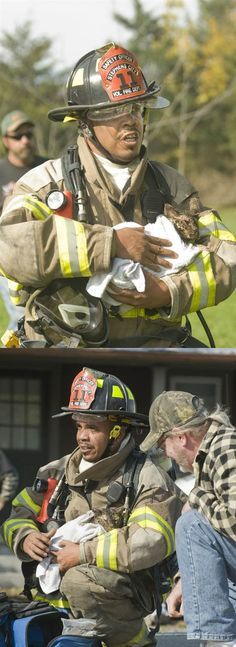 Stephens City volunteer firefighter, Pete Quinones, cradles Lucky - who he rescued from a Virginia house fire. | Shared by LION