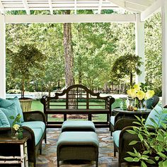 In good Southern tradition, Bethany wanted plenty of porches. On the wraparound front porch is a large seating group consisting of a classic Lutyens bench paired with all-weather wicker.