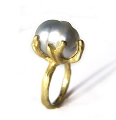 A hand sculpted organic setting in 18 karat yellow holds a large baroque South Sea Pearl Pearl measures at 16mm tall by 9mm wide This ring is a size 7, but can be resized upon request. Please call the