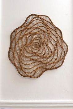 This incredible sculpture captures the flow and energy of natural materials in an eye catching wall art piece . Art Fibres Textiles, Textile Fiber Art, Wall Sculptures, Sculpture Art, Circular Weaving, Weaving Art, Macrame Patterns, Land Art, Wire Art