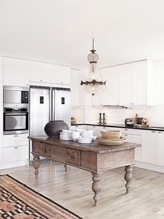 This island! Rustic statement island, vintage chandelier, in a clean modern kitchen feels fresh and unique.