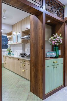 A sea green cabinet at the entrance of this open kitchen Interior design ideas from a Mumbai apartment that is Indian in design and modern in outlook. Designed by Studio Node, a Mumbai-based interior designer. Kitchen Room Design, Home Room Design, Modern Kitchen Design, Home Decor Kitchen, Interior Design Kitchen, Kitchen Furniture, Kitchen Ideas, Interior Design Blogs, Interior Decorating