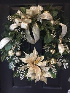 Size 30  An elegant wreath made with layers of wired ribbon in cream and gold. The poinsettias are stunning and loaded with sparkles and gems. The platinum glittered fern spray give a great contrast and airiness and the leaf spray with iridescent gems on the petals make it sparkle.