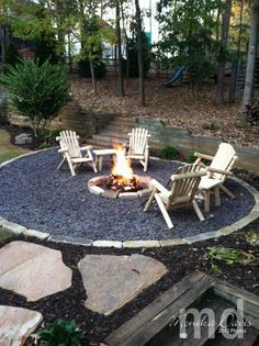 Firepit by Stampin' Up: cut the circle/snail shape into the yard. then laid the paver stones along the edge by the grass and also around the circle for the fire – underneath is something like sand but it had a different name. Then the filler where t