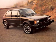 1984 VW GTI Rabbit 5 speed- This was the 9th new car I purchased.... seemed to move like a pocket rocket. Black with red interior.