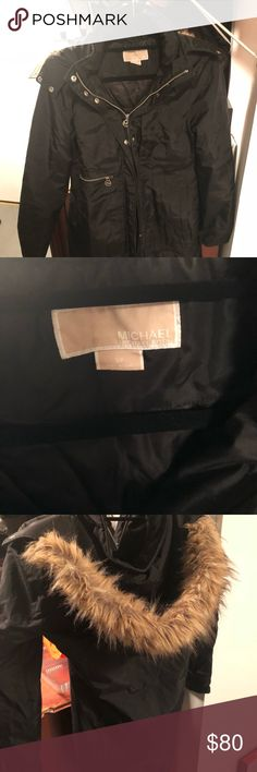 Michael Kors Jacket Stylish Black Michael Kors jacket with fur hood. Wore maybe twice... medium length.. I have tons of long Michael Kors jackets... I needed to try a medium length one... just not my style... feel free to send an offer... no rips or holes! Great condition! Michael Kors Jackets & Coats Puffers