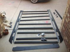 An 80/20 extruded aluminum commercially produced roof rack.  A plasma, some forms and a metal brake and you could make this for the Tahoe.