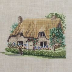 Completed Cross Stitch Betty's Cottage on Linen Custom Framed