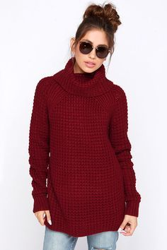 No matter where you go, you'll always be reminded of home in the Parker Bridge Burgundy Sweater! This comfy and cozy waffle knit sweater has a large cowl neck, and long cuffed raglan sleeves. Ribbed knit attaches the raglan sleeves, runs down the sides of the roomy bodice, and ends with adorable side slits.