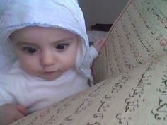 Baby perusing the Qur'an!