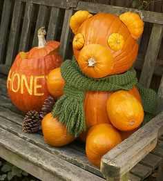 You'll need classic orange pumpkins in all different sizes to make this honey bear.  How-Tos 1.  To make the body, attach a medium-size pumpkin to a larger pumpkin with a 3/4-inch wooden dowel (use a drill to make holes in each).  2.  For the arms and legs, cut the top off of orange gourds, hollow out, and attach to pumpkin body with 1/2-inch wooden dowels.  3.  Use Jack Be Little pumpkins for the face. Cut one in half for the ears, cut two in half for the eyes (use the pumpkin tops with…