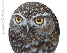 An Elegant Snowy Owl Hand Painted on a Sea Rock! A Unique Piece of Art and a great Gift Idea for all of you, owl lovers!  My painted stones are unique pieces of art. I paint all of them with high quality acrylics and very small brushes. They are painted on smooth sea stones, FINELY DETAILED, protected with a strong transparent varnish coat, signed on the back and accompanied by a CERTIFICATE OF AUTENTICITY.  * Measurements of this hand painted snowy owl: Height 8 cm (3,2 in) *  ** I work…