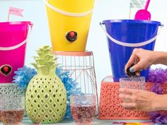 Entertain this summer by turning a plastic beach bucket into a wine keg. Because wine not?