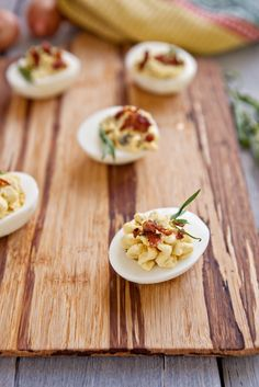 Hard boiled eggs deviled with capers, fresh tarragon, spicy Dijon, and a bit of crisped ham to finish it all off. An easy way to twist your deviled egg recipe for Easter. circulon