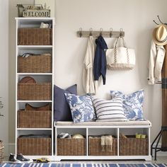 entry way idea love all the storage (hidden in baskets) can change out the pillows for the time of year can do this same look with IKEA  Kallax units + sturdy bench